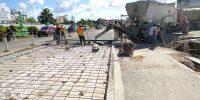 Belize Road Safety Belmopan concrete roundabout road pavement construction